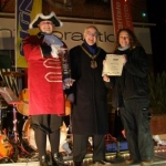 Winner of the Best-decorated Shop- Taylors Florist with the Town Crier and Chair of the LCC- Tony Kershaw.jpg